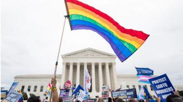 Protesters rally in front of the Supreme Court as it hears arguments on whether gay and transgender people are covered by a federal law barring employment discrimination on the basis of sex on Tuesday, Oct. 8, 2019