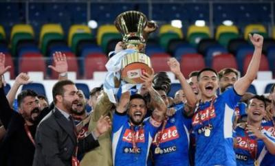 Napoli celebrate with the Coppa Italia trophy