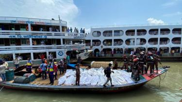 Rescue workers bring bodies of victims after a ferry capsized at the Sadarghat ferry terminal in Dhaka on June 29, 2020.