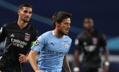 David Silva runs with the ball in the Champions League defeat by Lyon