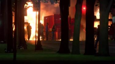 A screen grab from a video shows a fire started by protesters in Kenosha, Wisconsin