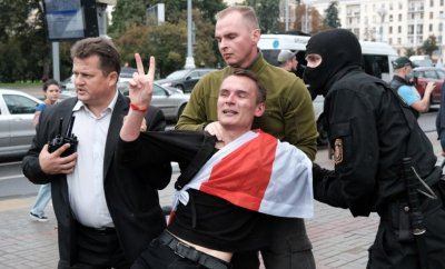 A student flashes the victory sign as he is detained by law enforcement officers during a protest against presidential election results in Minsk, Belarus September 1, 2020
