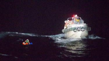 Patrol ship rescuing a seaman