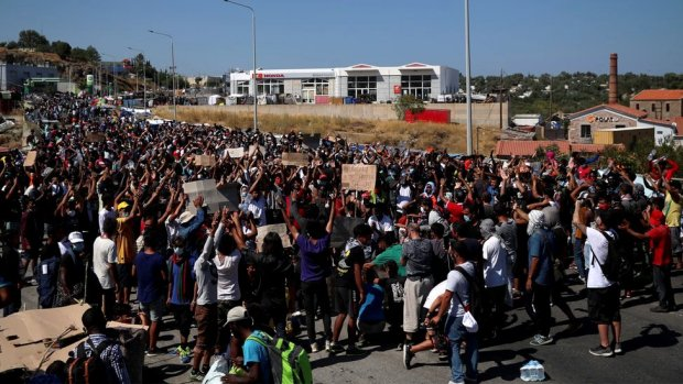 Refugees and migrants from the destroyed Moria camp protest after the news about the creation of a new temporary camp on the island of Lesbos, Greece, 11 September 2020