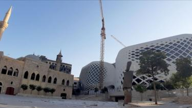 The façade a new Beirut commercial complex designed by the late British-Iraqi architect Zaha Hadid. On the left is the Lebanese capital's Majidiyah mosque. 5 August 2020