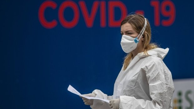 A masked health worker stands near a Covid-19 testing centre in Prague, Czech Republic on 17 September