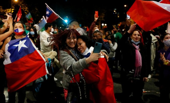 "Supporters of the ""I Approve"" option react after hearing the results of the referendum on a new Chilean constitution in Valparaiso, Chile, October 25, 2020"