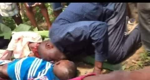 Heartbreaking photo of father planting a kiss on his 11-year-old dead son killed in Cameroon school shooting
