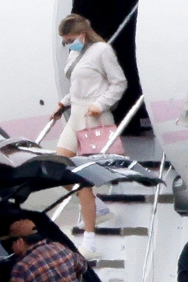 Kylie Jenner and Travis Scott seen getting off a private jet with daughter Stormi, 2, after fun-filled weekend getaway (photos)