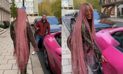 Moment DJ Cuppy walked in on a man trying to take photos with her Ferrari (video)