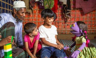 Tuktuki muppet meets children in Cox's Bazaar. Credit: Ryan Donnell