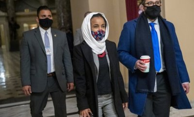 Democratic Congresswoman from Minnesota Ilhan Omar (C) walks to the House floor from her office inside the US Capitol in Washington, DC, USA, 12 January 2021.
