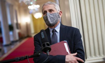 Anthony Fauci, director of the National Institute of Allergy and Infectious Diseases, wears a protective mask while speaking to members of the media