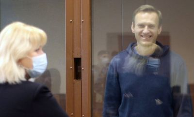 Russian opposition leader Alexei Navalny inside a glass cage prior to a hearing of a case on slander charges in Moscow, Russia, 16 Feb