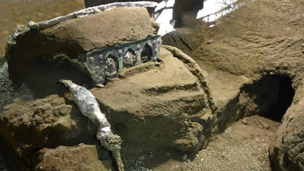An image of partially unearthed carriage