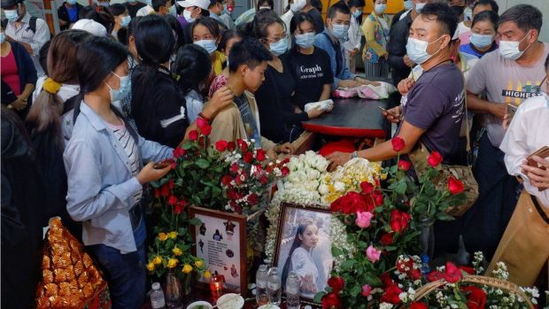 People attend the funeral of Angel, 19-year-old protester also known as Kyal Sin