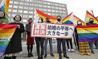 """Plaintiffs"""" lawyers and supporters show a banner that reads """"Unconstitutional decision"""" after a district court ruled on the legality of same-sex marriages outside Sapporo district court in Sapporo, Japan"""