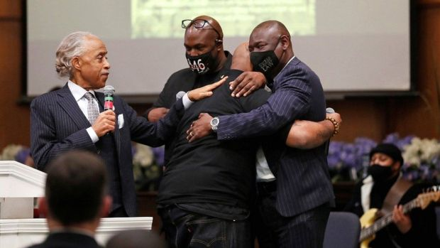 Terrence Floyd, brother of George Floyd, is comforted by Rev Al Sharpton (L), his brother Philonise Floyd, and attorney Ben Crump (R), during a prayer vigil the day before opening statements in the trial of former police officer Derek Chauvin, who is facing murder charges in the death of George Floyd, in Minneapolis, Minnesota, on 28 March 2021