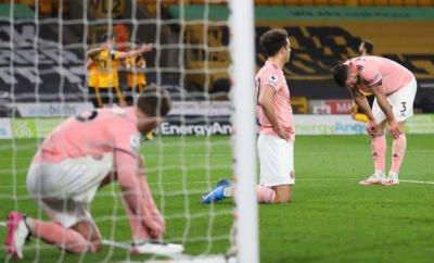 Sheffield United players look despondent after Wolves score