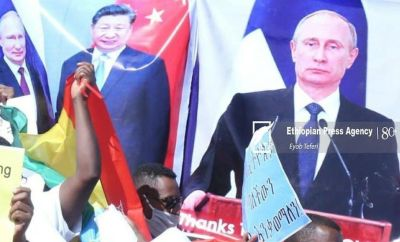 Some people held placards criticising Mr Biden while others applauded Russia's President Vladimir Putin and China's leader Xi Jinping.