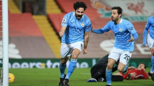Ilkay Gundogan of Manchester City (left) celebrates with team-mate Bernardo Silva after scoring against Liverpool