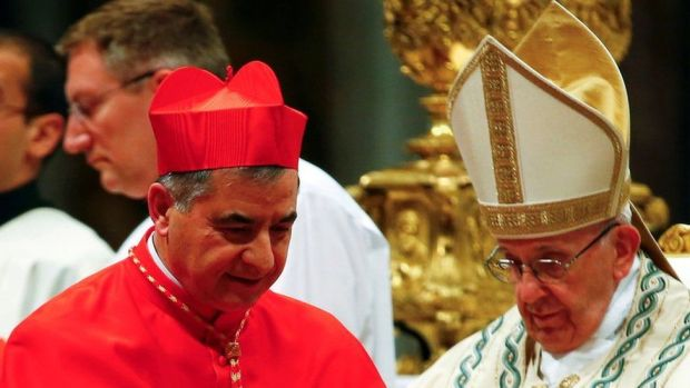 Cardinal Giovanni Angelo Becciu pictured with Pope Francis