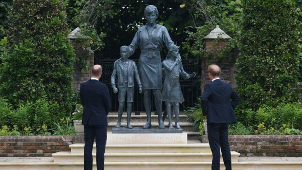 Prince Harry and Prince William next to the statue of Diana