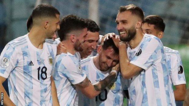 Lionel Messi is congratulated by team-mates after scoring against Ecuador