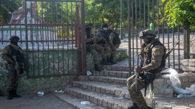 Troops guard the residence where President Moise was shot