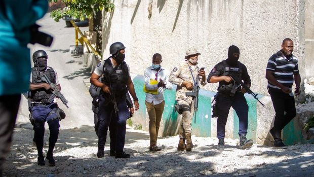 Police agents work near the house of the assassinated Haitian president, Jovenel Moise in Port-au-Prince