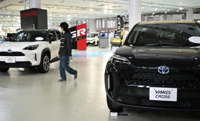 A person at a Toyota showroom in Tokyo.