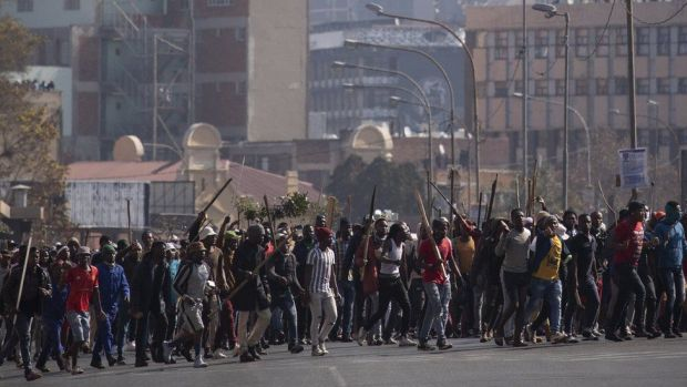 A supporter of ex President Jacob Zuma during ongoing violent clashes in downtown Johannesburg, South Africa, 11 July 2021.