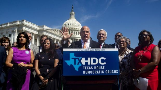 Chair of the Texas House Democratic Caucus Chris Turner (C) speaks at a news conference held by Democratic members of the Texas state legislature