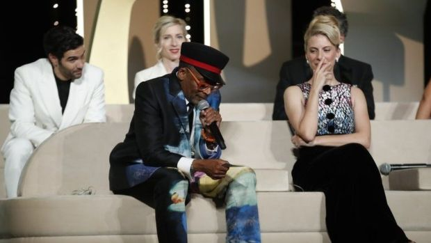 Spike Lee speaks on stage next to other members of the jury during the Closing Awards Ceremony