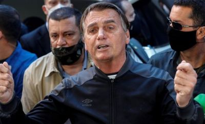 Brazilian President Jair Bolsonaro delivers remarks after he was discharged from the Vila Nova Star Hospital