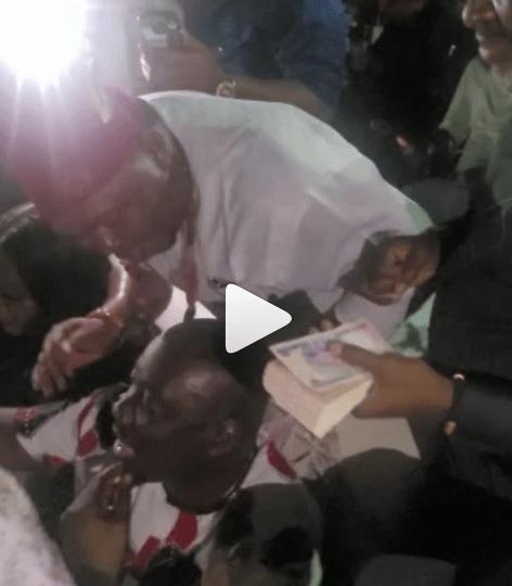 Obi Cubana hilariously makes sign of the cross as Actor Kanayo O. Kanayo sprays him money at his mother?s burial ceremony (video)