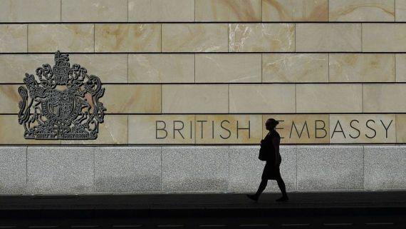 A woman walks past the UK embassy in Berlin