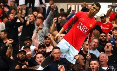 Man Utd fans hold Cristiano Ronaldo cardboard cut out at Wolves