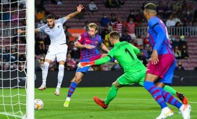 Domingos Duarte heads in for Granada at Barcelona