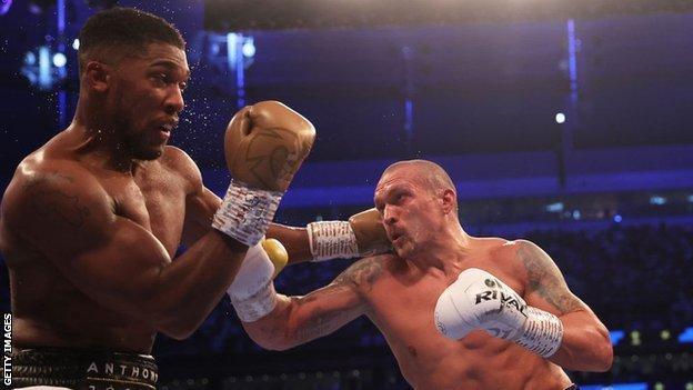 Oleksandr Usyk punches Anthony Joshua