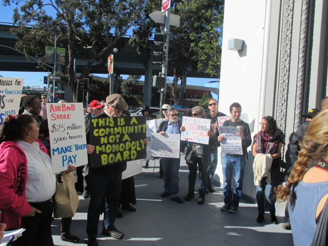 A crowd in front of Airbnb kicks of a campaign for a 2015 ballot measure