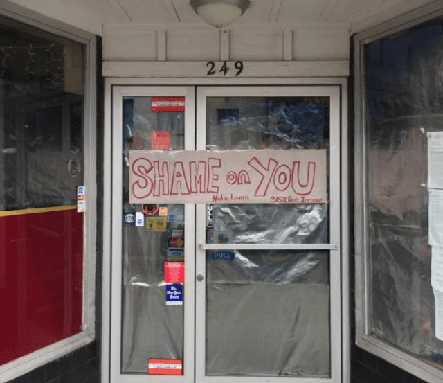 "A much-loved corner store now has a ""shame"" poster on it, thanks to one family member. Photo from Bernalwood"