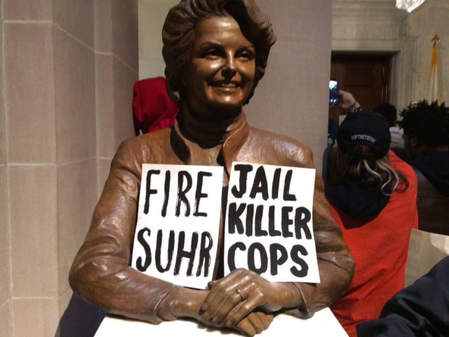 A bust of former Mayor Dianne Feinstein carries the message of the protest