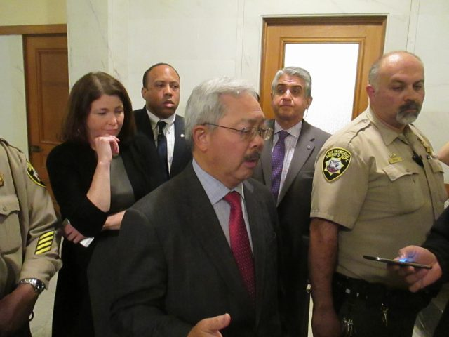 Mayor Lee talks with reporters after the board meeting