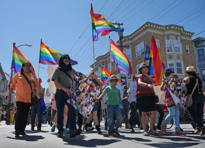 The 'Amor y Solidad' march from the Castro to the Mission on Saturday, June 18.