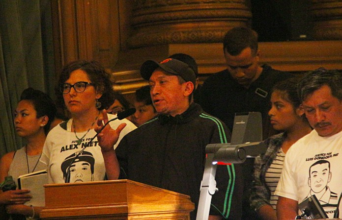 Jose Gongora Pat, brother of Luis Gongora speaks to the board of supervisors in support of Sup. Avalos's proposal. Photo by Sana Saleem.