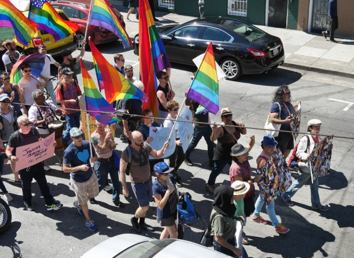 The march symbolically united the Latino and LGBT communities. Photo by David Schnur