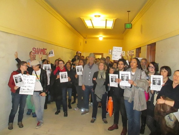 Protesters pack the hall outside the sheriff's office