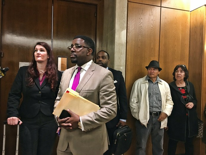 Attorney Adante Pointer answers questions after the hearing on Monday. Photo by Sana Saleem.