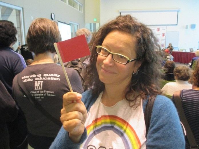 Teacher and union activist Alisa Messer shows one of the many red flags